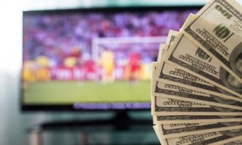 Dollar bills and football on TV