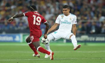 Casemiro of Real Madrid tackles Sadio Mane of Liverpool